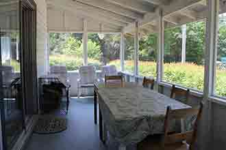 The White Cottage screened-in porch