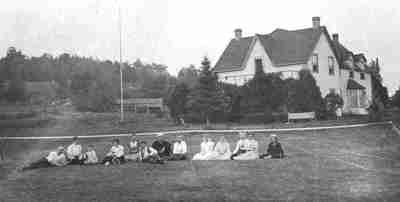 1900: After a game of tennis on the Clyffe House front lawn